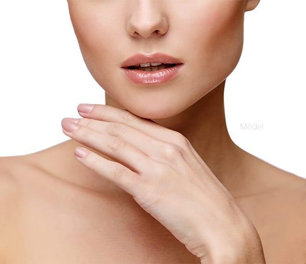 Beautiful woman touching face