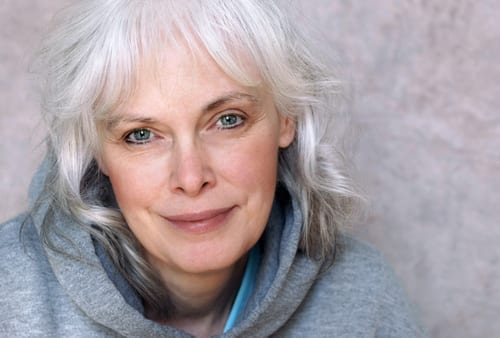 portrait of happy mature woman with natural white hair and minimal makeup-img-blog