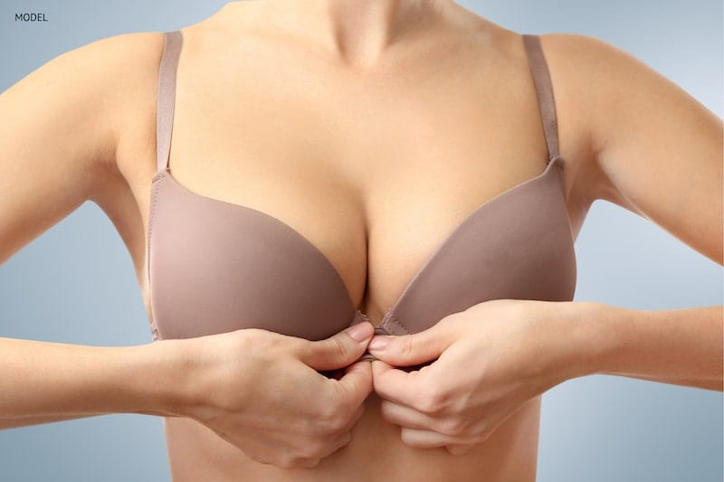 Woman fastening a front closing bra.