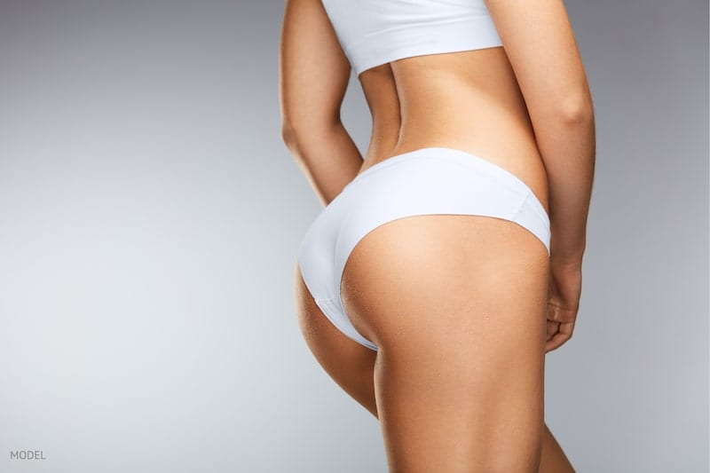 Close-up-image of woman's backside with firm buttocks-in-white-underwear